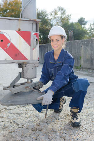 equalize: Woman lowering foot of crane
