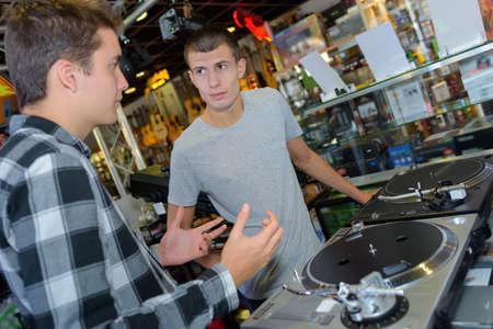 persuades: conversation in a disc jockey shop