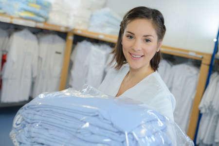 girl packing blouses