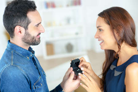 accepting: Woman accepting ring from man Stock Photo