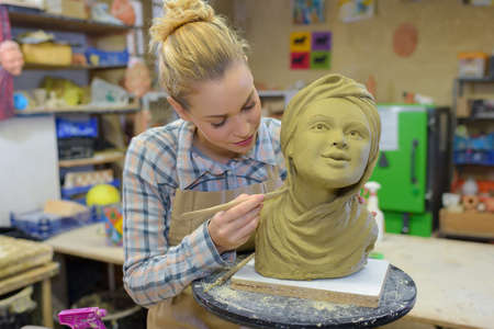 Artist working on bust