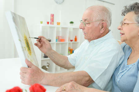 two stroke: elderly man painting