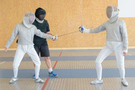 plastron: three fencers on a practice