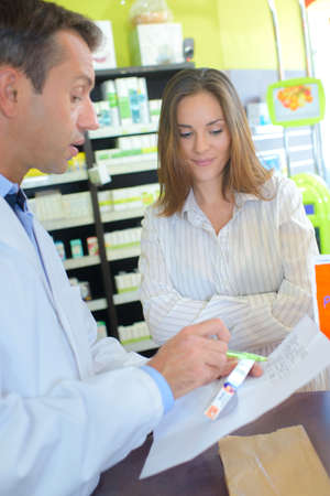 customer records: advice on the dosage Stock Photo