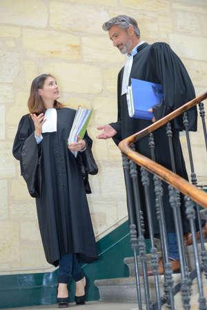 proceeding: attorneys talking while walking Stock Photo