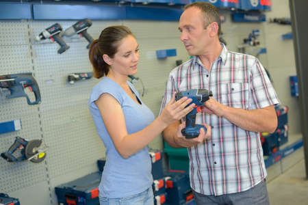 power tool: Man and woman purchasing power tool