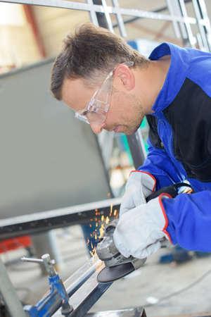 safety googles: polishing a steel Stock Photo