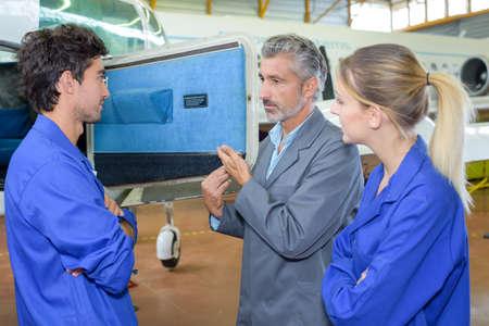 hangar: aviation engineers in hangar Stock Photo
