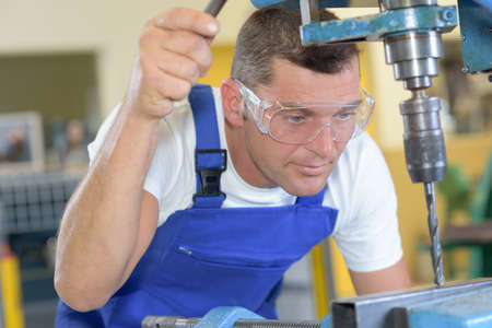man drilling Stock Photo