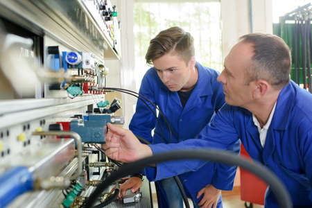 Technician teaching apprentice Stock Photo