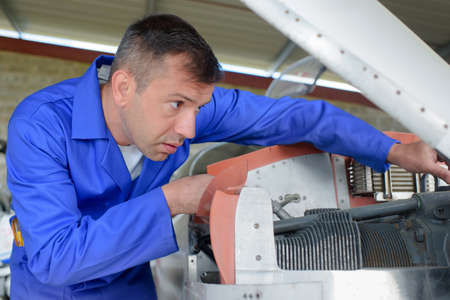 aligning: Engineer aligning shaft Stock Photo