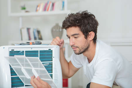 Man assembling air conditioning unit
