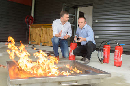 Men training with fire extinguishers