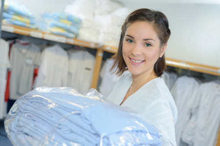 portrait of worker putting away laundry in hospital Imagens