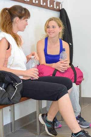 rehydration: Young ladies in sports changing room