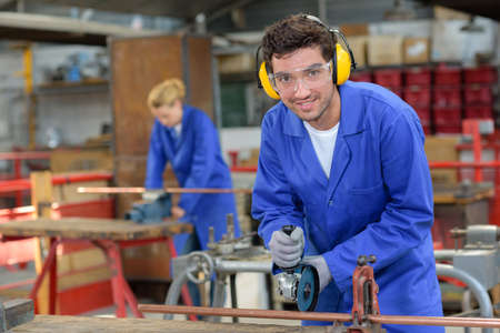 industrial noise: industrial worker wearing earmuffs and goggles Stock Photo