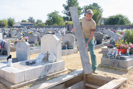 cemetary: man working in cemetary