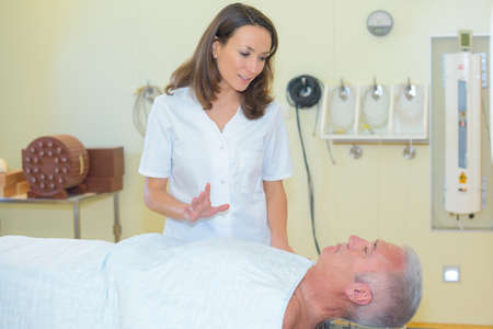 instructing: instructing the patient Stock Photo