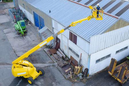 elevator operator: fixing warehouse roof