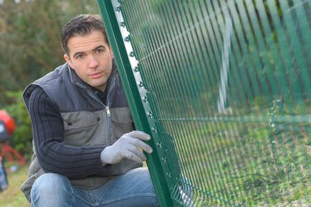 fencing: man installing a fencing