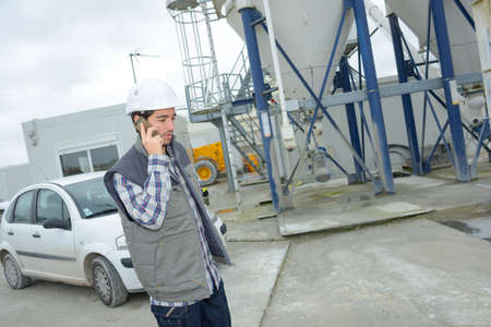 combines: cement plant worker on the phone