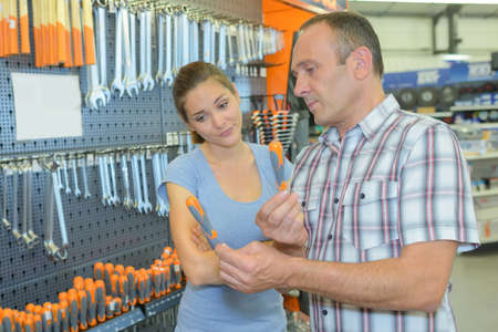 reluctant: Couple choosing screwdriver