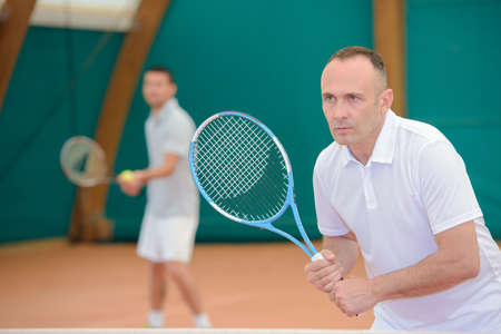 competitive sport: Two men on tennis court Stock Photo