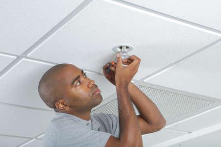 light duty: putting a light bulb Stock Photo