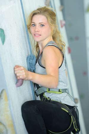 Lady climbing sports wall Stock Photo