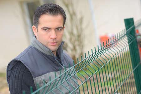 trespass: man at a fence