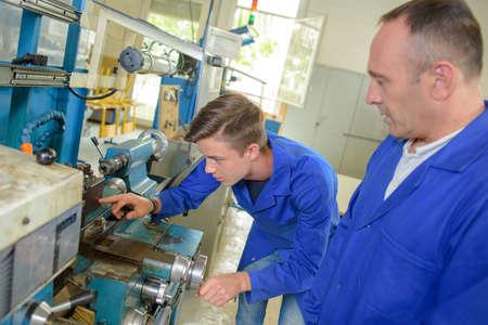 machinist: machinist studying a machine