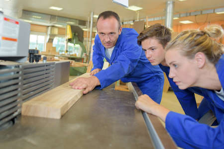 ear muffs: group of students in woodwork training course Stock Photo