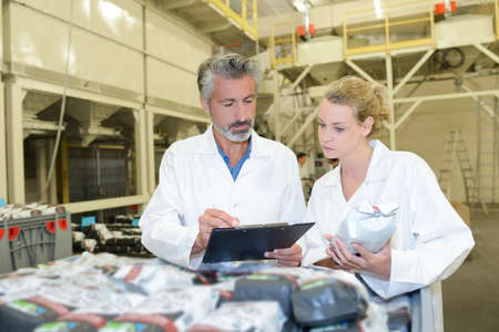 food industry: Man and woman checking produce Stock Photo