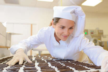 Chef organising chocolates