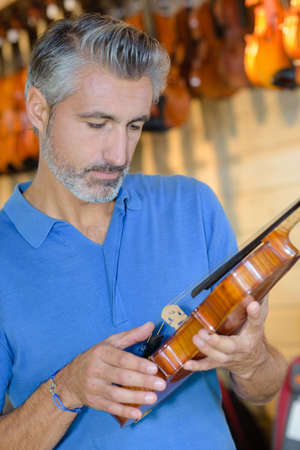 checking the violin components