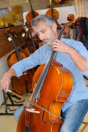 cellist: cellist testing the cello