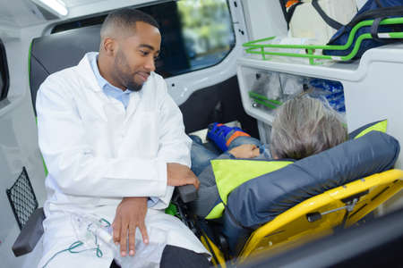 paramedic: Paramedic sat with patient in back of ambulance