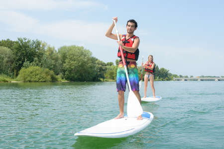 touring around on a paddle board