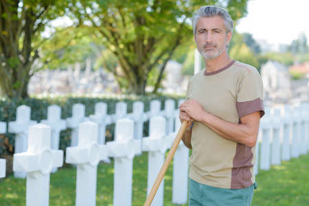groundskeeper: man in cemetary Stock Photo