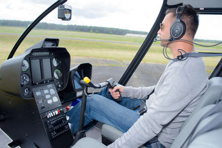 helicopter pilot flying Stock Photo