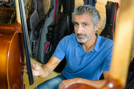 pitched: Man with double bass Stock Photo