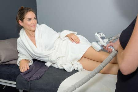 upper leg: Woman having treatment on upper leg