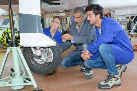 avionics: avionics apprentice and teacher Stock Photo
