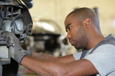 malfunction: diesel mechanic fixing a vehicle