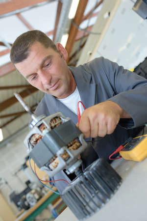 fabricator: electrical assembly worker Stock Photo