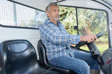 farm duties: driving a vehicle Stock Photo