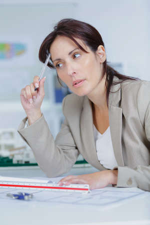 thinking woman: business woman thinking