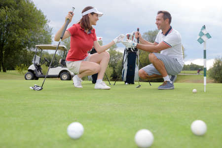 match: conversation in the golf course Stock Photo