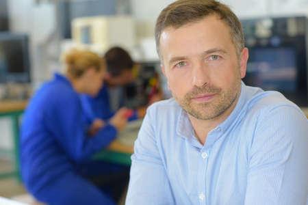 partake: vocational teacher posing Stock Photo