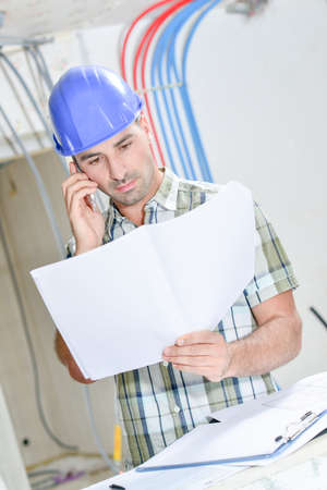 Building consulting plans on telephone Stock Photo